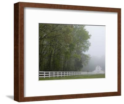 White Farmhouse and Fence in Mist, Powhatan, Virginia, USA