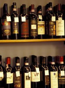 Wine Display, Pienza, Tuscany, Italy by John & Lisa Merrill