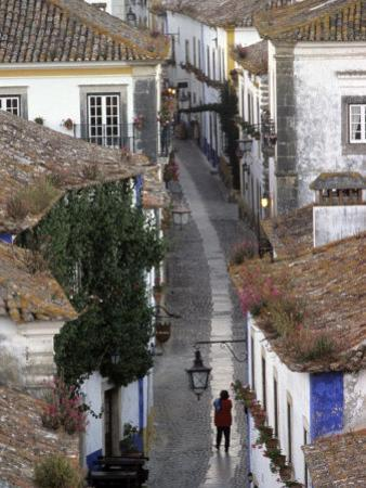 Woman in Narrow Alley with Whitewashed Houses, Obidos, Portugal