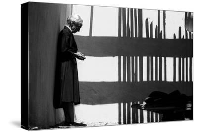 Artist Georgia O'Keeffe Against a Wall Amidst the Shadows of a Fence, Abiquiu, New Mexico, 1966