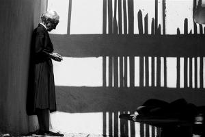 Artist Georgia O'Keeffe Against a Wall Amidst the Shadows of a Fence, Abiquiu, New Mexico, 1966 by John Loengard