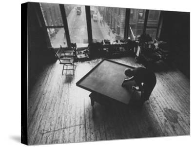 Leader of Minimal Art Movement Ad Reinhardt Working on One of His 'Black' Paintings