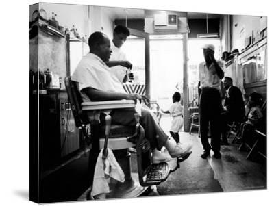 Musician Louis Armstrong in His Neighborhood Barber Shop