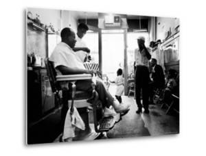 Musician Louis Armstrong in His Neighborhood Barber Shop by John Loengard