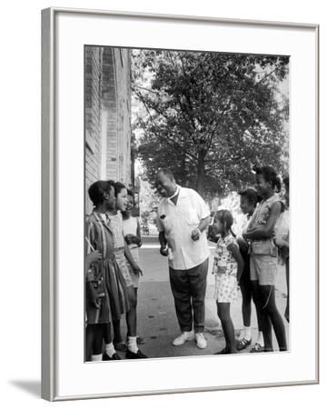 Musician Louis Armstrong with Neighborhood Kids
