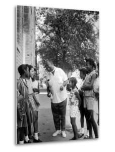 Musician Louis Armstrong with Neighborhood Kids by John Loengard