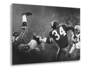 NY Giant Don Chandler Making a Punt in a Football Game Against the Green Bay Packers by John Loengard