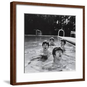 Paul McCartney, George Harrison, John Lennon and Ringo Starr Taking a Dip in a Swimming Pool by John Loengard