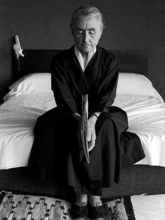 Portrait of Artist Georgia O'Keeffe Holding a Book by Leonard Baskinin Her Bedroom