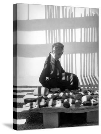 Portrait of Artist Georgia O'Keeffe Sitting Among Rock Collection