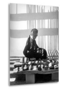 Portrait of Artist Georgia O'Keeffe Sitting Among Rock Collection by John Loengard