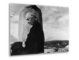 Portrait of Artist Georgia O'Keeffe Sitting on the Roof of Her Ghost Ranch Home by John Loengard