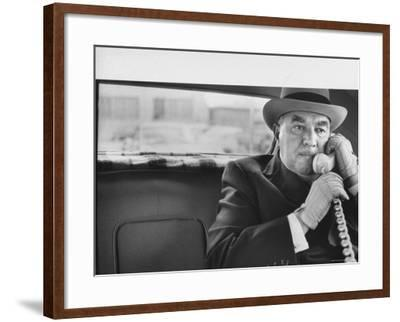 Realtor William J. Zeckendorf, Sitting in the Back Seat of His Limousine Talking on the Telephone