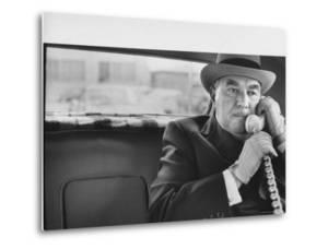Realtor William J. Zeckendorf, Sitting in the Back Seat of His Limousine Talking on the Telephone by John Loengard