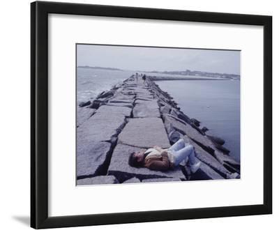 Senator Edward M. Kennedy Basking in Sun on Breakwater in Hyannis Port