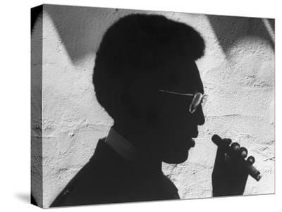 "Silhouette of Actor/Comedian Bill Cosby with Cigar, Former Star of TV Series ""I Spy"""