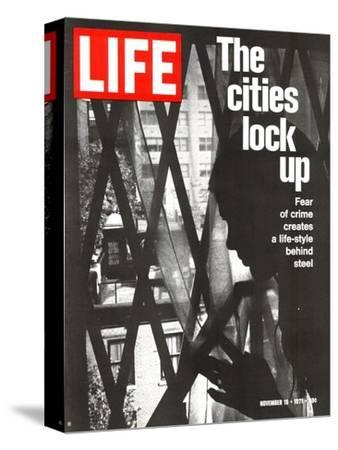 The Cities Lock Up, Woman at Gated Window, November 19, 1971