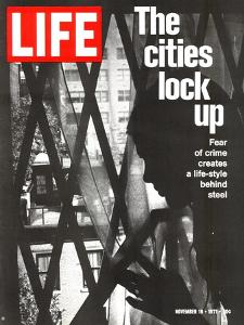 The Cities Lock Up, Woman at Gated Window, November 19, 1971 by John Loengard