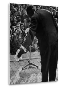 Trumpeter Louis Armstrong Bowing to a Spellbound Dutch Audience During a Concert with His Band by John Loengard