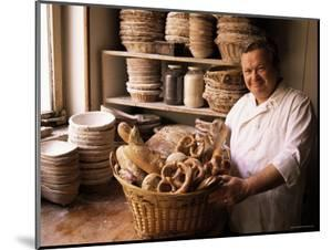 Baker with Selection of Bread, France by John Miller