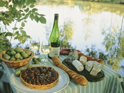 Food and Wine on a Table Beside the River Loire, France
