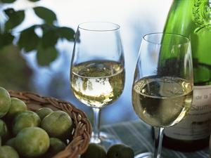 Glasses of White Wine on Table With River Relected in Glass, Loire, France, Europe by John Miller