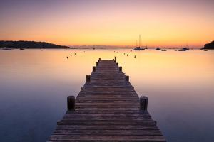 Wooden jetty at dawn, sunrise, long exposure, Corsica, France, Mediterranean, Europe by John Miller