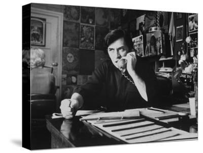 Bill Graham, Owner of Filmores East and West, Talking on Phone as He Works in His Office