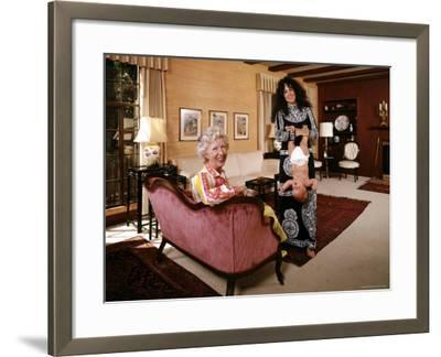 Grace Slick Holding Her Daughter Upside Down by the Ankles