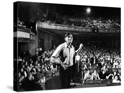Rock Promoter Bill Graham Onstage with Audience Visible, at Fillmore East