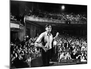 Rock Promoter Bill Graham Onstage with Audience Visible, at Fillmore East by John Olson