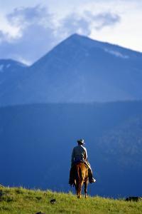 LONE COWBOY RIDING THE RANGE IN MONTANA by John P Kelly