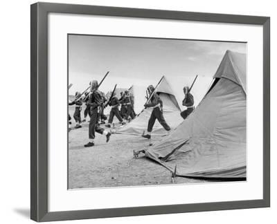Arab Legion Men Emerging from Behind their Tents to Go to the Training Ground