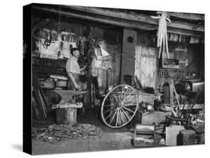 Blacksmith Working in His Shop by John Phillips