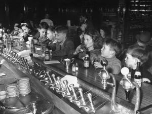 British Refugee Children Eating Ice Cream and Drinking Ginger Ale at a Soda Fountain by John Phillips