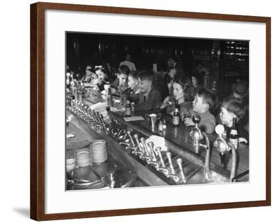 British Refugee Children Eating Ice Cream and Drinking Ginger Ale at a Soda Fountain