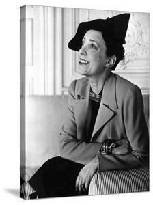 """Elsa Schiaparelli Wearing a Jacket of Her New Magenta Color Known as """"Shocking."""" by John Phillips"""