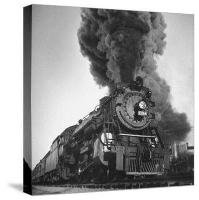 Engine Spewing Smoke as Train Proceeds En Route