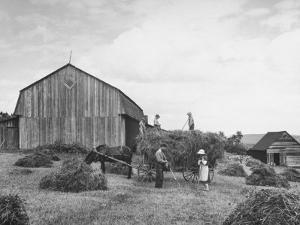 Family Praying During Farm Work by John Phillips