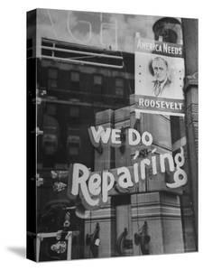 Franklin D. Roosevelt Poster Hanging in a Repair Store Window on Madison Avenue by John Phillips