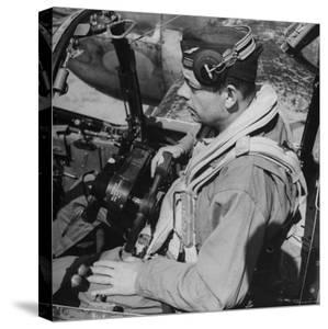 French Aviator/Author Antoine de Saint Exupery Sitting in Cockpit of Fighter Plane by John Phillips