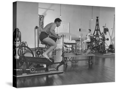 Men Exercising in Gymnasium at Homestead Hotel