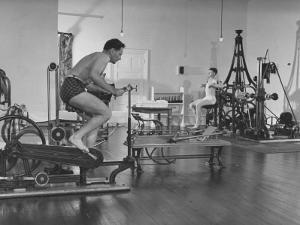 Men Exercising in Gymnasium at Homestead Hotel by John Phillips