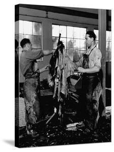 Men Scraping Clots of Hair from the Leather at the Tannery by John Phillips
