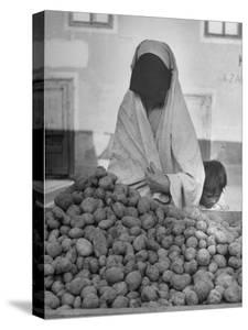 Moslem Woman Shopping for Potatoes by John Phillips