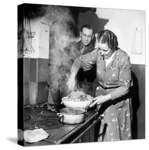 Signora Socci Cooking Spaghetti Dinner for American Sergeant Alexander before He Leaves by John Phillips