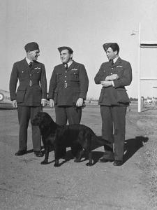 Three British R.A.F. Officers: R.E. Dupont, R.H. Waterhouse and Mellor Chatting at Camp Borden by John Phillips