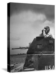 Troop Member Standing Up, Out of the Tank, Looking Through His Binoculars by John Phillips