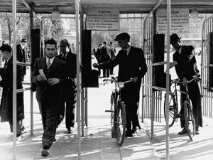 Workers Clocking in at the Gates on Labour Square by John Phillips