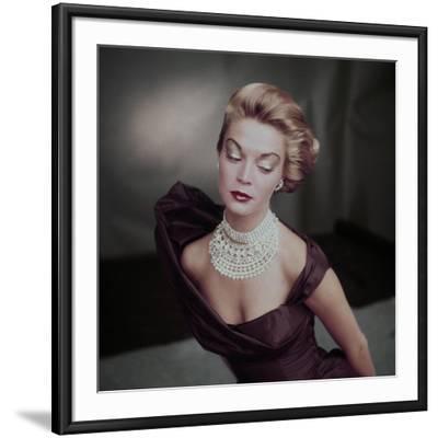 Model Jean Patchett Wearing Golden Brown Open Neck Satin Evening Dress
